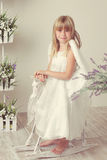 Girl in an angel dress Stock Images