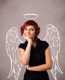 Girl with angel illustrated wings on grungy background Stock Photos