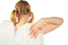Girl in angel's costume from back touches wing Stock Image