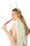 Girl in angel's costume with red feather Stock Image