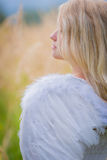 Girl with angel wings on the back Royalty Free Stock Photos