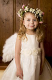 The girl an angel on a wooden background Royalty Free Stock Photos
