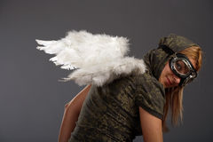 The girl with angelic wings. And glasses Stock Photo