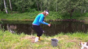 Girl angler catch crucian, give hungry cat. Leisure in nature stock video footage
