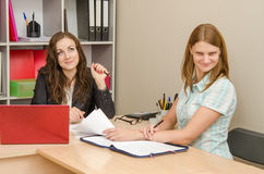 The girl is angry from indifference to the problem at the office specialist Royalty Free Stock Photography