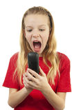 Girl is angry on the phone Royalty Free Stock Image
