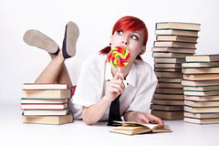 The girl in anime style with candy and books royalty free stock photo