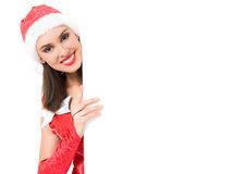 Girl with announcement. Happy girl portrait wearing Santa dress and Santa hut with empty announcemant board Stock Photos
