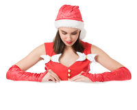Girl with announcement. Girl wearing Santa dress and Santa hut with announcemant board Royalty Free Stock Photo
