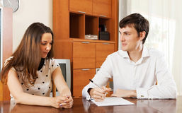 Girl answer questions of outreach worker. With paper at home Royalty Free Stock Images
