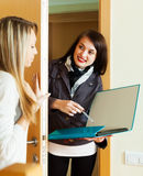 Girl answer questions of smiling girl at home Stock Images
