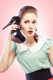 Girl answering the shoe call Stock Image
