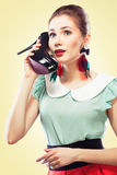 Girl answering the shoe call Stock Photo