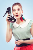 Girl answering the shoe call Royalty Free Stock Photos