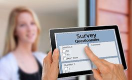 Girl answering survey questionnaire interview on tablet Royalty Free Stock Photography