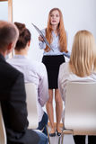 Girl answers questions on interview Royalty Free Stock Photo