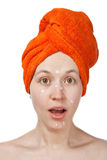 The girl a anti-akne cream on the face. The girl with an open mouth, anti-akne cream on the face and towel Royalty Free Stock Photo