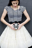Girl with Antique Camera Stock Images