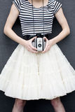 Girl with Antique Camera Royalty Free Stock Image