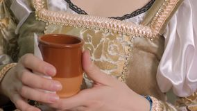 Girl in antique embroidered dress drinking at gala dinner, first night out. Stock footage stock video