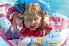 Girl in a apool having fun on holidays. Royalty Free Stock Image