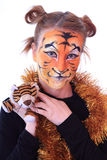 Girl in appearance a tiger with a toy tiger cub. stock images
