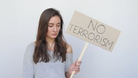 Girl Appearing against Terrorism with Tablet stock footage