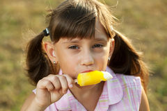 Girl with an appetite for eating ice cream Royalty Free Stock Photos