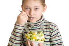 Girl with appetite eats dessert Stock Image