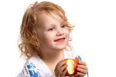 Girl with an apple. Girl tasted an apple: portrait of a girl holding an apple in her hands Royalty Free Stock Photography