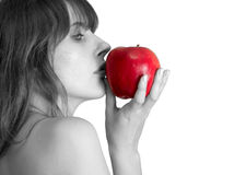 The girl and an apple;. Portrait of the beautiful bared girl kissing an apple royalty free stock photo