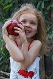 GIRL With APPLE. A funny  girl with an apple Stock Photos