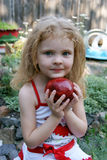 GIRL With APPLE. A funny  girl with an apple Royalty Free Stock Images