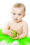 Girl with apple. Portrait of a little girl with green apple isolated Stock Photography