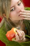 Girl with apple. Pretty girl is holding a juicy apple in  palm Stock Photos