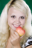 Girl with an apple Royalty Free Stock Images