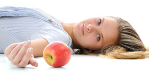 The girl and an apple. Royalty Free Stock Photos