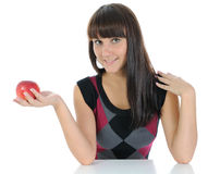 The girl and apple. Royalty Free Stock Photos