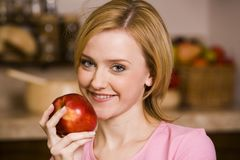 Girl with an apple Royalty Free Stock Photos
