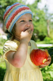 The girl with an apple. The girl holds an apple Stock Photo