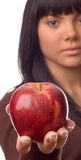 The girl with an apple Stock Images