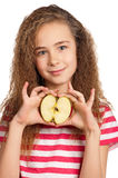 Girl with apple. Portrait of happy girl with apple isolated on white background Stock Photos