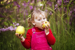 Girl and apple Royalty Free Stock Photo