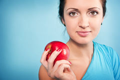 Girl and apple Stock Image