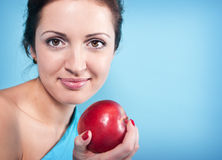 Girl and apple Stock Photography