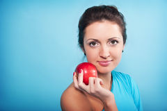 Girl and apple Royalty Free Stock Images