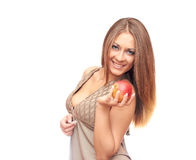 Girl with apple. Smiling girl holding an apple in his hand Stock Photography