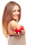 Girl and apple. Smiling girl holding an apple in her hand Stock Photo