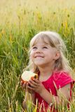 Girl with apple Royalty Free Stock Images