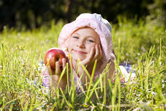 Girl with an apple Stock Photography